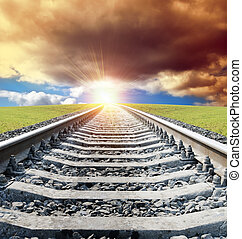 rail goes to sun in dramatic sky
