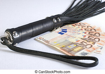 Black Leather Flogging Whip and money on white background.