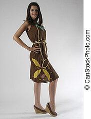 brunette model in a dress