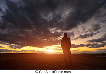 Silhouette of man at the sunset Emotional scene