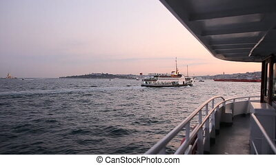 Travel along Bosphorus during sunse