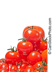 Variety of tomatoes piled up and isolated on white background