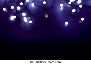 defocused abstract blue christmas lights - close-up of...