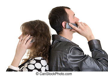 boy and girl talking by cell phone