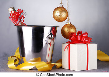 christmas symbols - bucket with champagne bottle and...