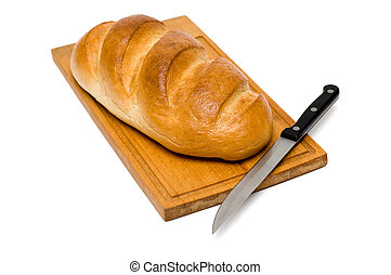 fresh natural bread with knife on breadboard
