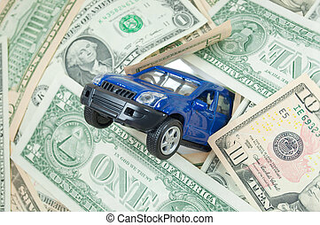 Car insurance  - Toy car crashing through a wall of dollars