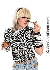 girl applying make up
