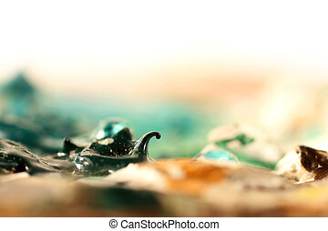 Green paint curl on Artist Palette - A curl of green paint...