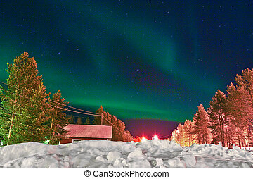 Northern lights (aurora borealis) display by night -...