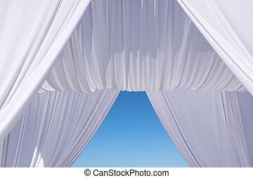 Wedding canopy under blue sky