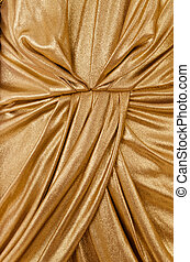 folds gold fabric closeup