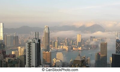 Time lapse Hong Kong skyline from famous Peak View at sunset...