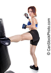 Woman Kick Boxer - Tough woman kickboxer practicing boxing...