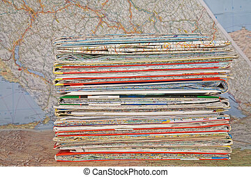 stack of various travel maps