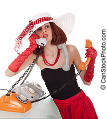 Confused fashion girl in retro style with three vintage phones on white background