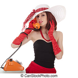 Fashion girl in retro style with vintage phone on white...
