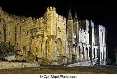 Popes palace in Avignon illuminated at night, France