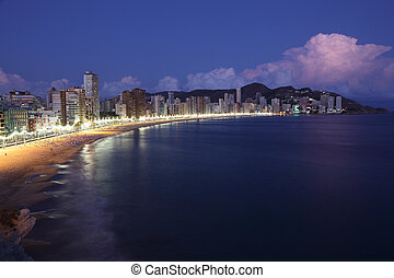 Highrise buildings along the beach of Benidorm at night, Spain