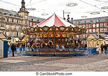 carousel for children at Madrids Plaza de major in Christmas...