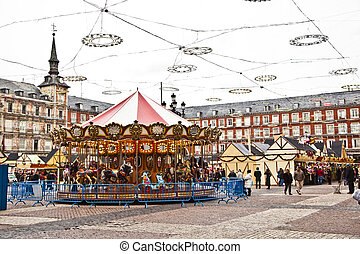 carousel for children at Madrids Plaza de major in Christmas...