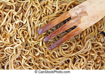 Close view cooked chow mein noodles - Very close view of...