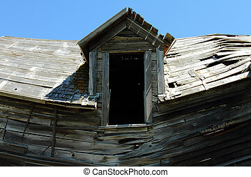 Collapsing Old House - Sagging roof line and wall of...