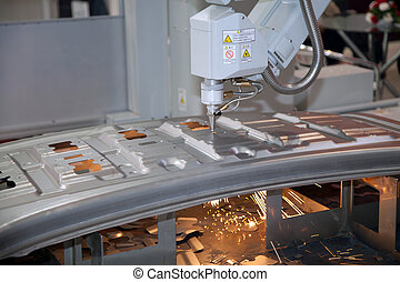 laser cutter - Laser cutter cutting through metal
