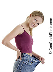 pretty girl in jeans lost weight on a white background