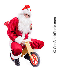 Photo of happy Santa Claus on bike with red sack. Isolated...