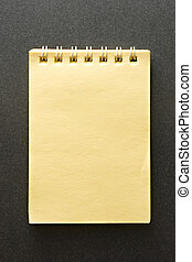 Notepad on the grey background