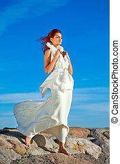 beautiful woman in white on seacoast - The elegant beautiful...