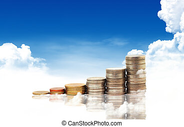 Invest. Conceptual image. and lot of coins over blue sky...