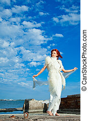 beautiful woman in white on seacoast - elegant beautiful...