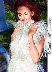 beautiful woman in white in sun beam - elegant beautiful...