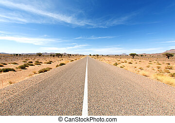 endless road - Endless road in Sahara Desert with blue sky,...