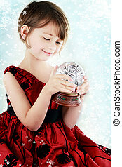 Child with Snow Globe - Happy little girl holding a snow...