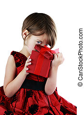 Child Peeking Into Giftbox - A young girl peeking into a...