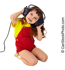 Little girl enjoys music in big headphones