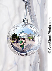christmas tree balls and mirroring of father and sun with...