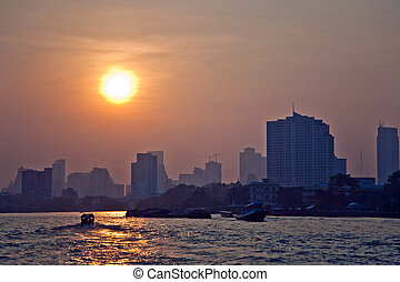 river Mae Nam Chao Phraya in Bangkok with panorama and...