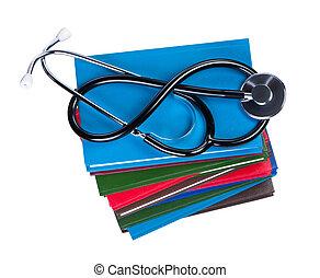 Medical stethoscope on pile books isolated.