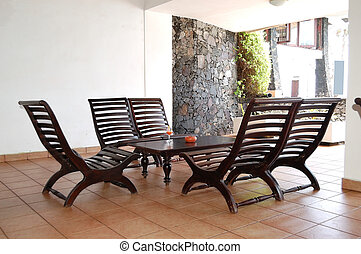 Table, chairs and glass of juice at popular hotel, Bentota, Sri Lanka