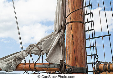 Masts and Sails - Old sailing ship masts and sails and...