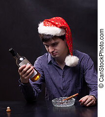 photo of man drinks alcohol and smokes a cigar
