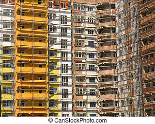Facade of modern apartment house construction with windows and balcony