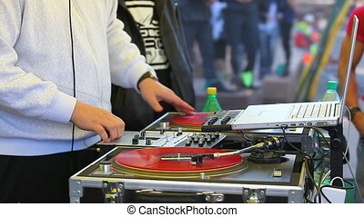 DJ playing music in the open air