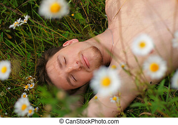 Image of a man who lay on the grass