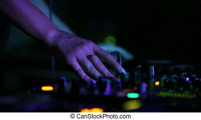 DJ playing music at the nightclub. hands close up