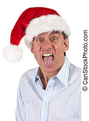 Man in Santa Hat Sticking Out Tongue - Headshot Portrait of...
